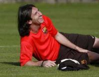 <p>Argentino Lionel Messi ri durante treino do Barcelona na Escócia, em foto de arquivo de 21 de julho. Photo by David Moir</p>