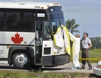 <p>Police cover up the front windshield of a Greyhound bus west of Portage la Prairie, Manitoba, July 31, 2008. A man sleeping on a Greyhound bus as it rolled across the Canadian Prairies was killed and decapitated by his seatmate on Wednesday night, other passengers on the bus told the media. REUTERS/Fred Greenslade</p>