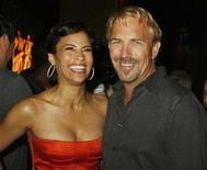 "<p>Actors Paula Patton (L) and Kevin Costner, stars of the film ""Swing Vote"", pose at the party following the film's premiere in Hollywood, California July 24, 2008. REUTERS/Fred Prouser</p>"