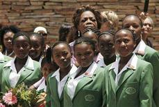 <p>Talk show host and businesswoman Oprah Winfrey watches with some of the first 152 students of the Oprah Winfrey Leadership Academy for Girls as a flag is raised during the opening of the school in Meyerton, outside Johannesburg January 2, 2007. A South African court on Friday postponed until October the trial of a former dormitory matron of U.S. talk show host Oprah Winfrey's girls academy charged with abusing minors. REUTERS/Siphiwe Sibeko</p>