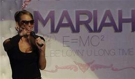 "<p>Singer Mariah Carey greets fans at an unveiling ceremony of a chair named ""Mariah""after her in Tokyo June 1, 2008. Surrounded by thousands of screaming fans, Carey performed five songs during a brief concert at a Hollywood shopping mall on Thursday. REUTERS/Kim Kyung-Hoon</p>"