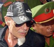 "<p>Former British ""glam rocker"" Gary Glitter (L), convicted and jailed in Vietnam for molesting children, arrives at the People's Supreme Court of communist-run Vietnam for appeal hearing in Ho Chi Minh City June 15, 2006. REUTERS/Kham</p>"