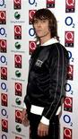 "<p>Musician Ian Brown poses at the ""Q Awards"" in London October 8, 2007. REUTERS/Anthony Harvey</p>"