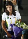<p>Juliana Silva, jogadora de vôlei de praia brasileira, ao chegar ao aeroporto de Pequim no dia 4  de agosto de 2008. Photo by Ceerwan Aziz</p>