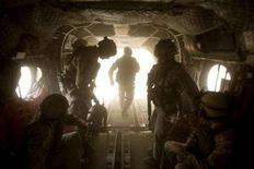 <p>Members of the Canadian delegation disembark from a Chinook helicopter as they arrive at Patrol Base Wilson in the Zhari District October 7, 2007. REUTERS/Paul Chiasson/Pool</p>