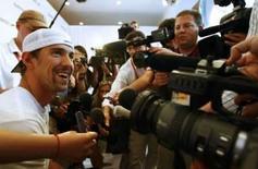 <p>O nadador Michael Phelps, dos Estados Unidos, dá entrevista coletiva depois de treino em Pequim. Phelps pode conquistar até 8 medalhas de ouro, superando o feito de seu compatriota Mark Spitz, sete ouros em 1972. Photo by Ruben Sprich</p>