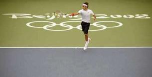 <p>O suíço Roger Federer treina em Pequim para os Jogos Olímpicos. Photo by Toby Melville</p>