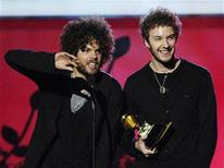 "<p>Members of Wolfmother, Myles Heskett (R) and Andrew Stockdale, accept the award for Best Hard Rock Performance for ""Woman"" at the 49th Annual Grammy Awards in Los Angeles February 11, 2007. REUTERS/Chris Pizzello</p>"