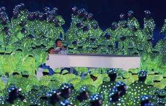<p>Pianist Lang Lang performs during the opening ceremony of the Beijing 2008 Olympic Games at the National Stadium, August 8, 2008. The stadium is also known as the Bird's Nest. REUTERS/Mike Blake</p>