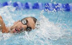 <p>Michael Phelps of the U.S.swims during a training session ahead of the Beijing 2008 Olympic Games August 8, 2008. REUTERS/Jason Reed</p>