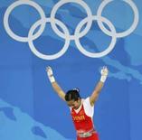 <p>Com novo recorde olímpico na categoria até 48kg, Chen Xiexia, do levantamento de peso, ficou com a primeira medalha de ouro da China nos Jogos deste ano.. Photo by Yves Herman</p>
