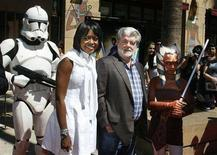 "<p>George Lucas, the executive producer of the new animated film ""Star Wars: The Clone Wars"" poses with his girlfriend Mellody Hobson and a Storm Trooper character (L) and character from the film Ahsoka Tano (R) at the film's U.S. premiere in Hollywood, California August 10, 2008. REUTERS/Fred Prouser</p>"