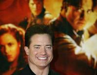 <p>Actor Brendan Fraser smiles for photographers as he arrives on the red carpet for the premiere of the film 'The Mummy: Tomb of the Dragon Emperor' in Tokyo August 4, 2008. REUTERS/Yuriko Nakao</p>