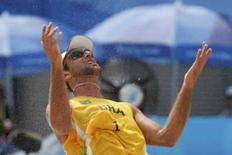 <p>Marcio Araujo e seu companheiro de dupla Fábio Luís, do Brasil, perderam para a os austríacos Clemens Doppler e Peter Gartmayer, por 2 sets a 1. Photo by Carlos Barria</p>
