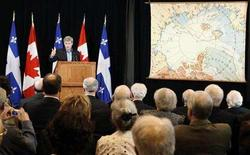 <p>Canada's Prime Minister Stephen Harper (top L) gestures after he unveiled a recently rediscovered map drawn by Canadian explorer Captain Joseph Elzear Bernier at the Garnison de Levis, July 31, 2008. REUTERS/Mathieu Belanger</p>