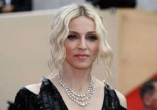 <p>Cantora madonna chega ao tapete vermelho em Cannes. Madonna escolheu a maison francesa de alta-costura Givenchy para criar os figurinos que ela usará em sua nova turnê mundial, 'Sticky and Sweet', que começa este mês na Grã-Bretanha, informou a grife na terça-feira. 21 de maio. Photo by Eric Gaillard</p>