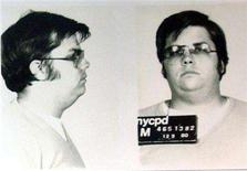<p>A mug-shot of Mark David Chapman, who shot and killed John Lennon, is displayed on the 25th anniversary of Lennon's death at the NYPD in New York December 8, 2005. REUTERS/Handout</p>