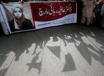 <p>Pakistani Islamist party activists protest to show the solidarity with U.S.-trained neuroscientist Aafia Siddiqui during a demonstration in Karachi August 10, 2008. REUTERS/Athar Hussain</p>