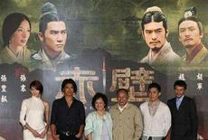 "<p>Taiwanese actor Chang Chen, Hong Kong actor Tony Leung, Hong Kong director John Woo, his wife, Annie Woo Ngau Chun-lung, Taiwan-born actor Takeshi Kaneshiro and Taiwan actress/model Lin Chi-ling pose (R-L) for a group photo during a news conference for their new film ""Red Cliff"" in Taipei July 8, 2008. REUTERS/Stringer</p>"