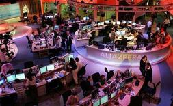 <p>Staff work at the English-language newsroom at the headquarters of the Qatar-based Al Jazeera satellite channel in Doha, November, 14, 2006. REUTERS/Mohammed Dubbous</p>