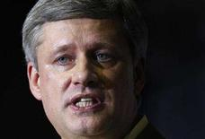 <p>Canada's Prime Minister Stephen Harper speaks during his speech at a barbecue in St-Agapit, July 30, 2008. An increasingly frustrated Harper was quoted on Thursday as suggesting he may have to force the dissolution of Parliament and trigger an election. REUTERS/Mathieu Belanger</p>