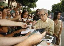 "<p>Woody Allen, director of the film ""Vicky Cristina Barcelona"", poses with fans at the film's premiere in Los Angeles August 4, 2008. Picture taken August 4. REUTERS/Fred Prouser</p>"