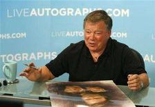 <p>Actor William Shatner gestures during an autograph session for LiveAutographs.com in Culver City, California August 13, 2008. LiveAutographs.com provides personalized video messages and authentic autographed memorabilia. REUTERS/Mario Anzuoni</p>