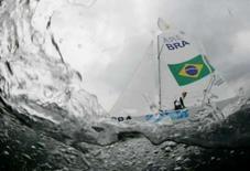 <p>Robert Scheidt e Bruno Prada, do Brasil, durante 1a regata da classe Star nos Jogos de Pequim, nesta sexta-feira. Os brasileiros terminaram em 10o lugar. Photo by Pascal Lauener</p>