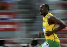 <p>Usain Bolt, da Jamaica, corre em sua bateria eliminatória dos 100 metros rasos, nesta sexta-feira, nos Jogos de Pequim. Photo by Kai Pfaffenbach</p>