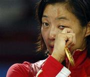 <p>Carol Huynh of Canada sheds tears of joy after winning the gold medal in the 48kg women's freestyle wrestling at the Beijing 2008 Olympic Games August 16, 2008. REUTERS/Issei Kato</p>