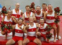 <p>Members from Canada's men's eight rowing team celebrate their gold medal win at the Beijing 2008 Olympic Games, August 17, 2008. REUTERS/Shaun Best</p>