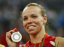 <p>Silver medallist Karen Cockburn of Canada poses during the medal presentation ceremony for the women's trampoline final at the Beijing 2008 Olympic Games August 18, 2008. REUTERS/Hans Deryk</p>