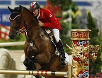 <p>Ian Millar of Canada riding In Style competes in the equestrian jumping team competition at the Beijing 2008 Olympic Games in Hong Kong August 18, 2008. REUTERS/Bobby Yip</p>