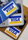 <p>Regular, platinum and gold Visa cards are displayed in New York March 18, 2008. REUTERS/Chip East</p>
