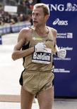 <p>Stefano Baldini durante la Maratona di New York del 5 novembre 2006. REUTERS/Shannon Stapleton (Usa)</p>