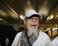 <p>British rocker Gary Glitter walks at Bangkok's Suvarnabhumi Airport August 20, 2008. REUTERS/Sukree Sukplang</p>