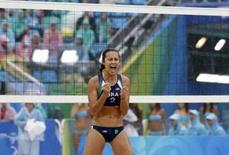 <p>Talita Rocha, da dupla Renata e Talita, comemora um ponto durante a prova de disputa da medalha de bronze, vencida pelas chinesas. Photo by Carlos Barria</p>