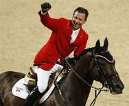 <p>Eric Lamaze of Canada riding Hickstead celebrates his win in the final round of the equestrian jumping individual event at the Beijing 2008 Olympic Games in Hong Kong August 21, 2008. REUTERS/Bobby Yip</p>