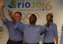 <p>Pelé, o presidente do COB, Carlos Arthur Nuzman, e a ex-jogadora de basquete Janeth Arcain durante evento da candidatura do Rio para os Jogos de 2016. Photo by Gil Cohen Magen</p>