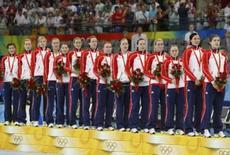 <p>Jogadoras na Noruega no alto do pódio após conquista da medalha de ouro no handebol feminino dos Jogos de Pequim, neste sábado. Photo by Mikhail Voskresensky</p>