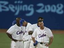 <p>Jogadores cubanos lamentam derrota para Coréia do Sul na final do beisebol dos Jogos de Pequim, neste sábado. Photo by Jessica Rinaldi</p>
