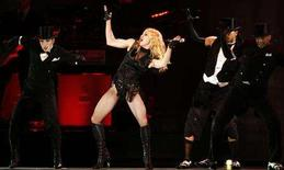 "<p>Madonna performs on the opening night of her ""Sticky & Sweet"" tour at the Millennium Stadium in Cardiff, August 23, 2008. REUTERS/Luke MacGregor</p>"