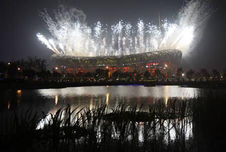 Fireworks illuminate the sky over the National Stadium, also known as the Bird's Nest, during the closing ceremony of the Beijing 2008 Olympic Games August 24, 2008. REUTERS/Claro Cortes IV