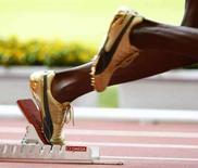 <p>Usain Bolt, da Jamaica, no bloco de partida para prova dos 200m nos Jogos de Pequim. Bolt conquistou 3 medalhas de ouro nos Jogos. Photo by ¸ Phil Noble</p>