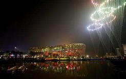 <p>Fireworks explode during the closing ceremony of the Beijing 2008 Olympic Games at the National Stadium, August 24, 2008. The stadium is also known as the Bird's Nest. REUTERS/Claro Cortes</p>