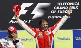 <p>O piloto brasileiro Felipe Massa (dir) comemora vitória np GP da Europa de F1m enquanto Lewis Hamilton ficou com o 2o lugar. Depois do emocionante Grande Prêmio da Europa, disputado neste fim de semana, a Ferrari e a McLaren, que lideram a atual temporada da Fórmula 1, apostam que caberá à resistência dos motores decidir o nome do campeão deste ano. Photo by Albert Gea</p>