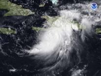 <p>O furacão Gustav é visto imagem de satélite de 26 de agosto. Os futuros do petróleo nos Estados Unidos tinham alta expressiva nesta terça-feira, impulsionados por uma possível ameaça às operações de produção pelo furacão Gustav. Photo by Reuters (Handout)</p>