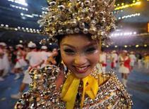 <p>Una partecipante allo spettacolo di chiusura delle Olimpiadi di Pechino 2008 REUTERS/Dylan Martinez</p>