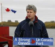 <p>Canadian Prime Minister Stephen Harper answers question at a news conference after touring the coast guard ship Nahidik north of the Arctic Circle in Tuktoyaktuk, Northwest Territories, August 27, 2008. REUTERS/Todd Korol</p>