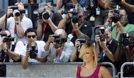"<p>South African actress Charlize Theron poses at her arrival at the Venice Film Festival August 29, 2008. Theron starred in the movie ""The Burning Plain"" by Guillermo Arriaga which was shown in the competition at the Venice Film Festival. REUTERS/Denis Balibouse</p>"